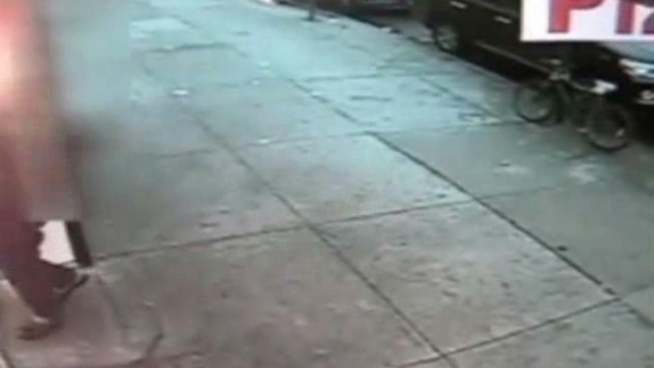 Police are trying to locate the man seen in this video shooting another man in front of 2085 Nostrand Ave. in Brooklyn last Saturday at about 7:30 p.m.