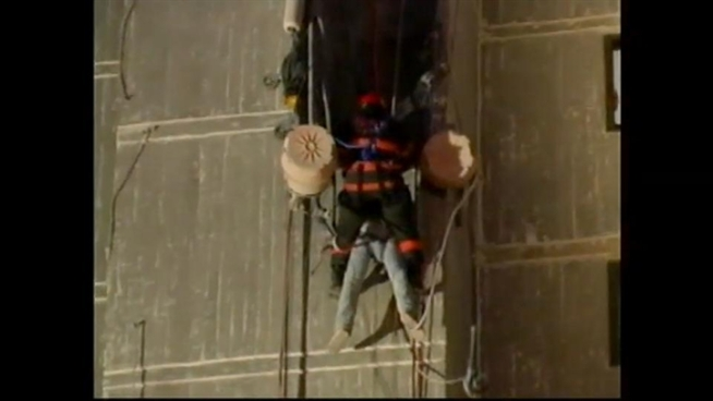 Using ropes to descend a hi-rise, hero firefighters say two workers stranded on a building.