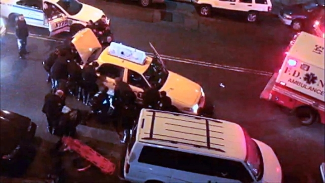 Video shows police officers lifting a taxi off of a pedestrian in the Bronx on Sunday. The man is in critical condition.
