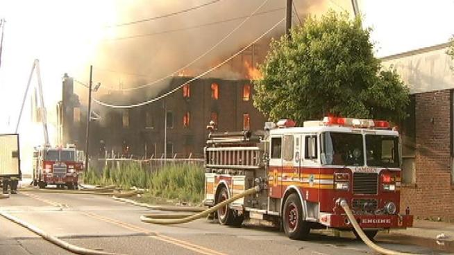 Camden officials are investigating a fire that tore through an abandoned chemical warehouse, the third major fire in the city this month.
