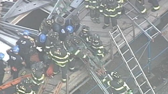 A building that was under construction in Brighton Beach, Brooklyn, collapsed suddenly Tuesday, trapping construction workers.