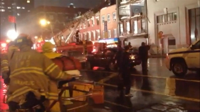 Firefighters respond to a building collapse at 15th Street and  8th Avenue in the Meatpacking District Monday evening.