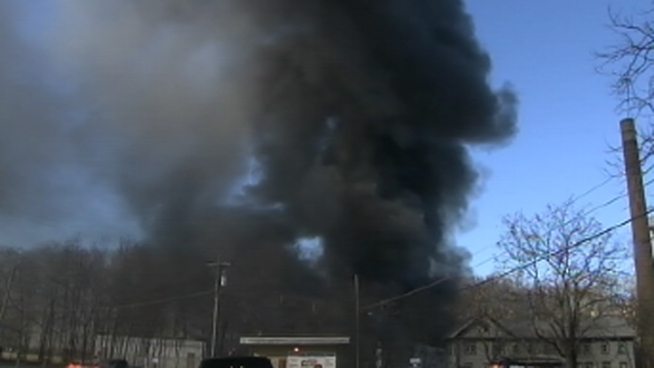 A massive fire has been burning at on old mill in Cornwall, N.Y., about 50 miles north of New York City. Thick black smoke could be seen for miles in either direction. This is raw video from the scene of the fire Sunday.