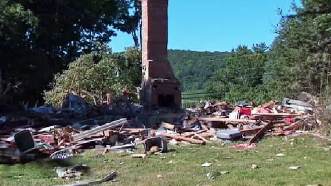 A chimney is all that's left of a New Milford home in Connecticut after it was leveled by an explosion Wednesday. A father is dead, and a little boy injured -- and it wasn't even their house. Brynn Gingras has more.