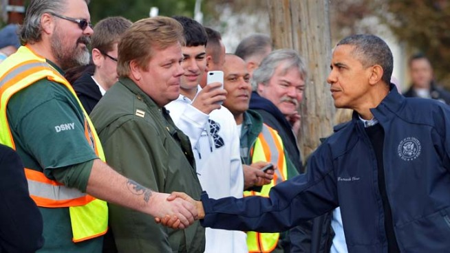 President Barack Obama toured the devastation that Sandy waged on New York City, flying over flood-ravaged Queens before landing in Staten Island to meet storm victims who lost homes and loved ones. Tracie Strahan reports.