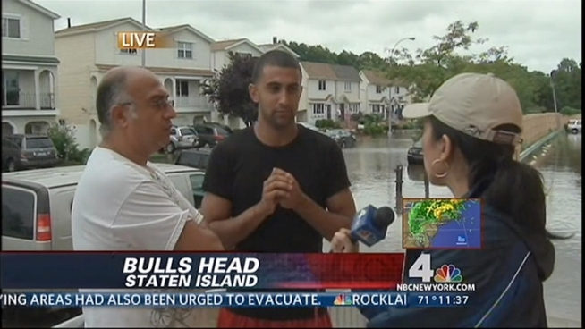 Firefighters rescued dozens of people by boat on Sunday as Irene passed through New York City.
