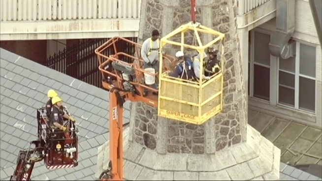 Two men were stuck in a construction bucket lodged against a New Jersey church steeple for hours Thursday before they were rescued in a daring operation. Andrew Siff reports.
