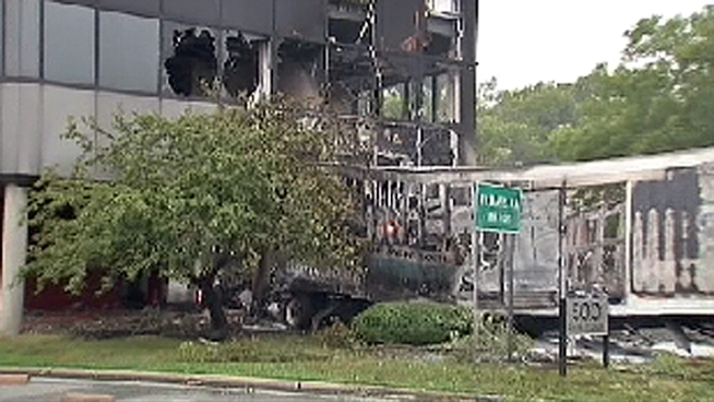 A tractor trailer careened off a highway in New Jersey Saturday morning, crashing into a building and causing causing major traffic delays.