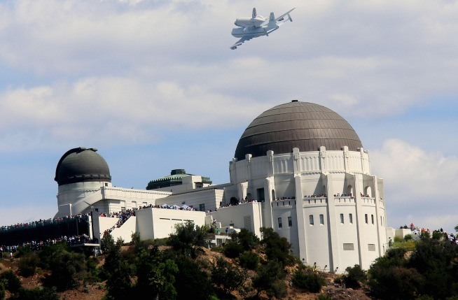 Watch as the retired space shuttle Endeavour soars over SoCal landmarks like the Hollywood sign and Griffith Observatory on Sept. 21, 2012.