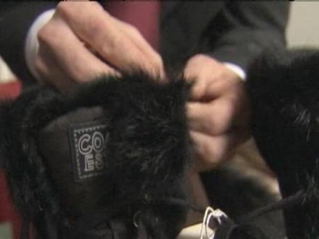 A designer parka advertised as being trimmed with fake fur is actually trimmed with the real thing, leaving animal lovers outraged.