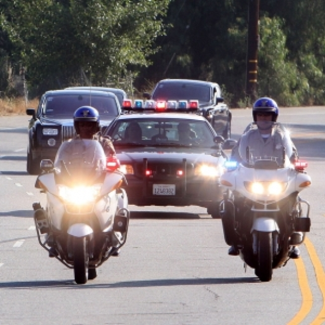 7:58 AM PDT - Jackson Family Motorcade Leaves Parents' Home