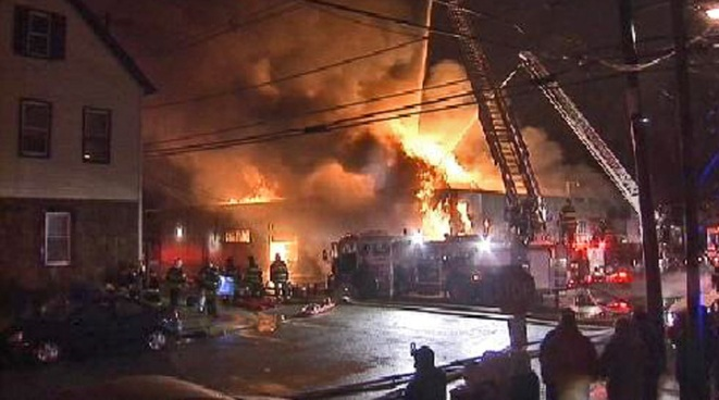 A seven-alarm fire broke out Tuesday morning at an auto repair shop in Elizabeth, N.J.