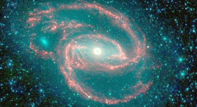 Galaxy Has Gas, Dust, Star Eating Monster at Center