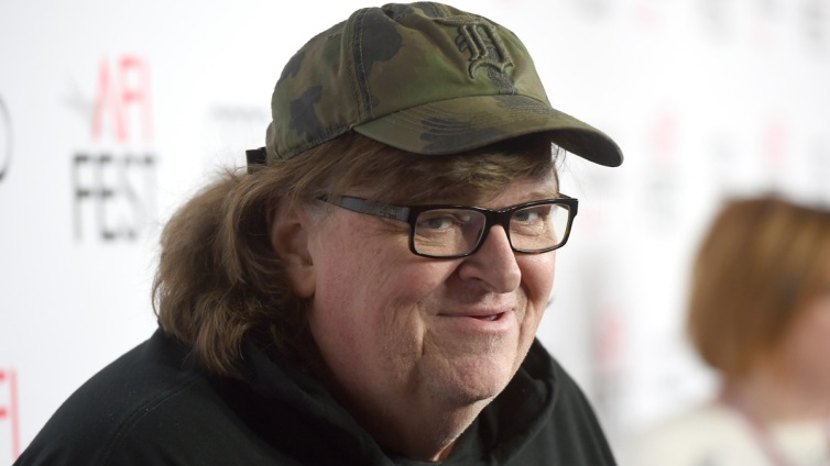Happening Today: Travel Ban, Hot Car Deaths, Michael Moore