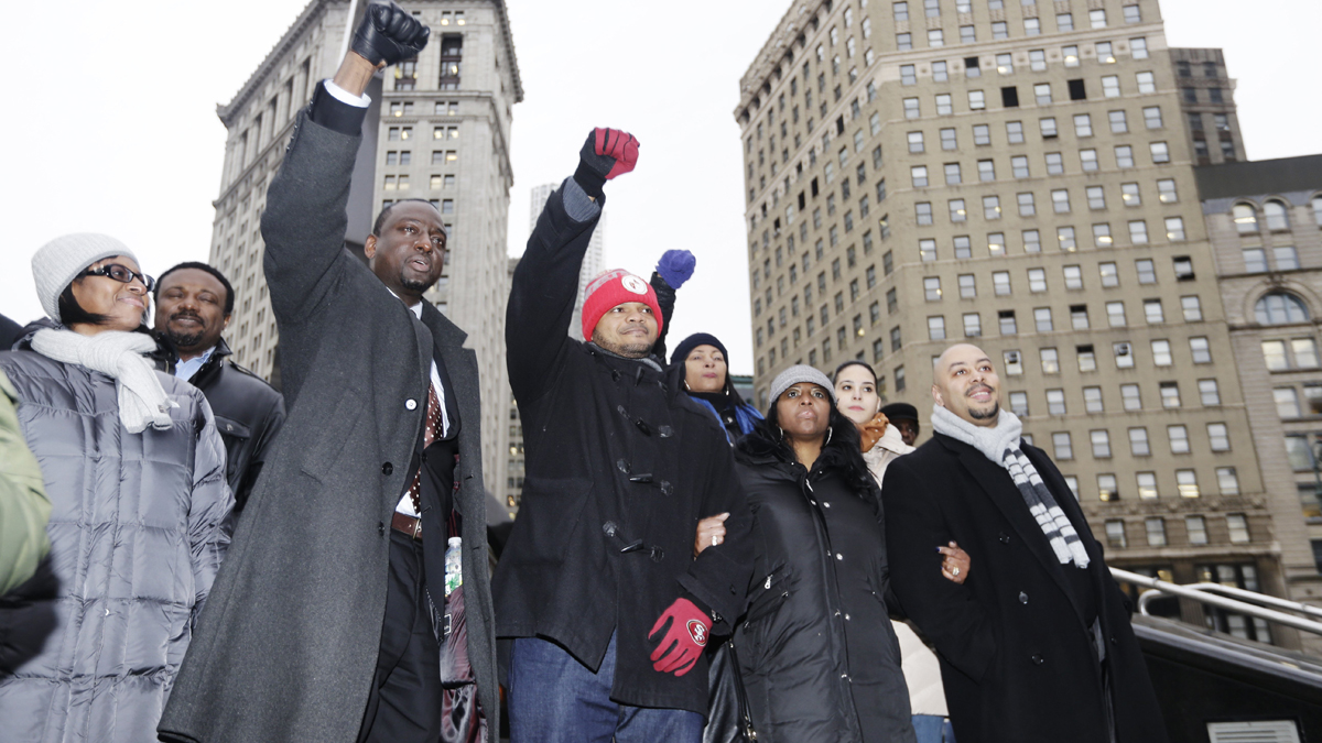 Raymond Santana, right, Kevin Richardson, and Yusef Salaam, left, react to supporters Thursday, Jan. 17, 2013, in New York. The three men who were exonerated in the 1989 Central Park Jogger case, were in court for a hearing in a $250 million federal lawsuit they filed against the city after their sentences were vacated. (AP Photo/Frank Franklin II)