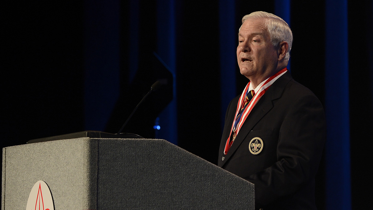 File Photo -- Former Defense Secretary Robert Gates addresses the Boy Scouts of America's annual meeting on Friday, May 23, 2014, in Nashville, Tenn., after being selected as the organization's new president.