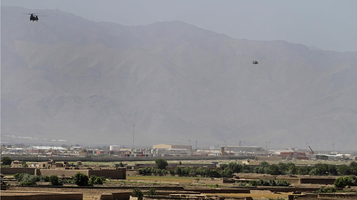 Helicopters take off from Bagram military base 31 miles north of Kabul, Afghanistan, June 19, 2013.