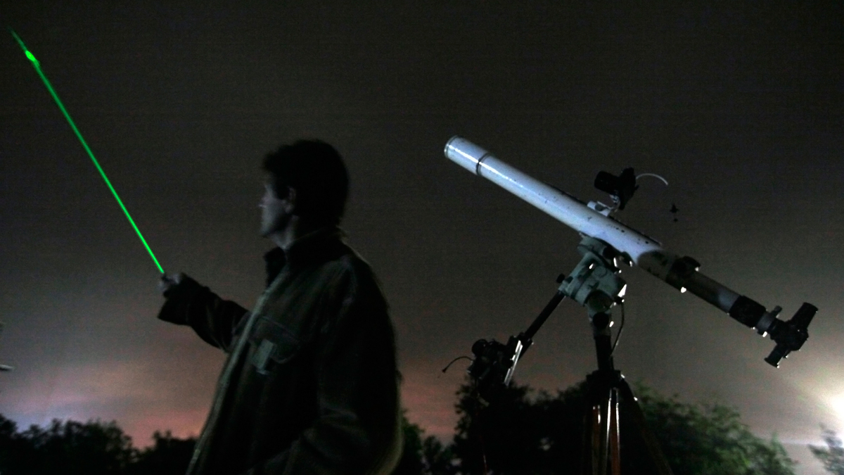 In this Oct. 20, 2009, file photo, an astronomer uses a laser pointer to show the radiance of the Orionids at an observatory in Bulgaria. The Orionid meteor shower occurs each year as a result of Earth passing through cosmic dust released by Halley's Comet. (AP Photo/Petar Petrov)