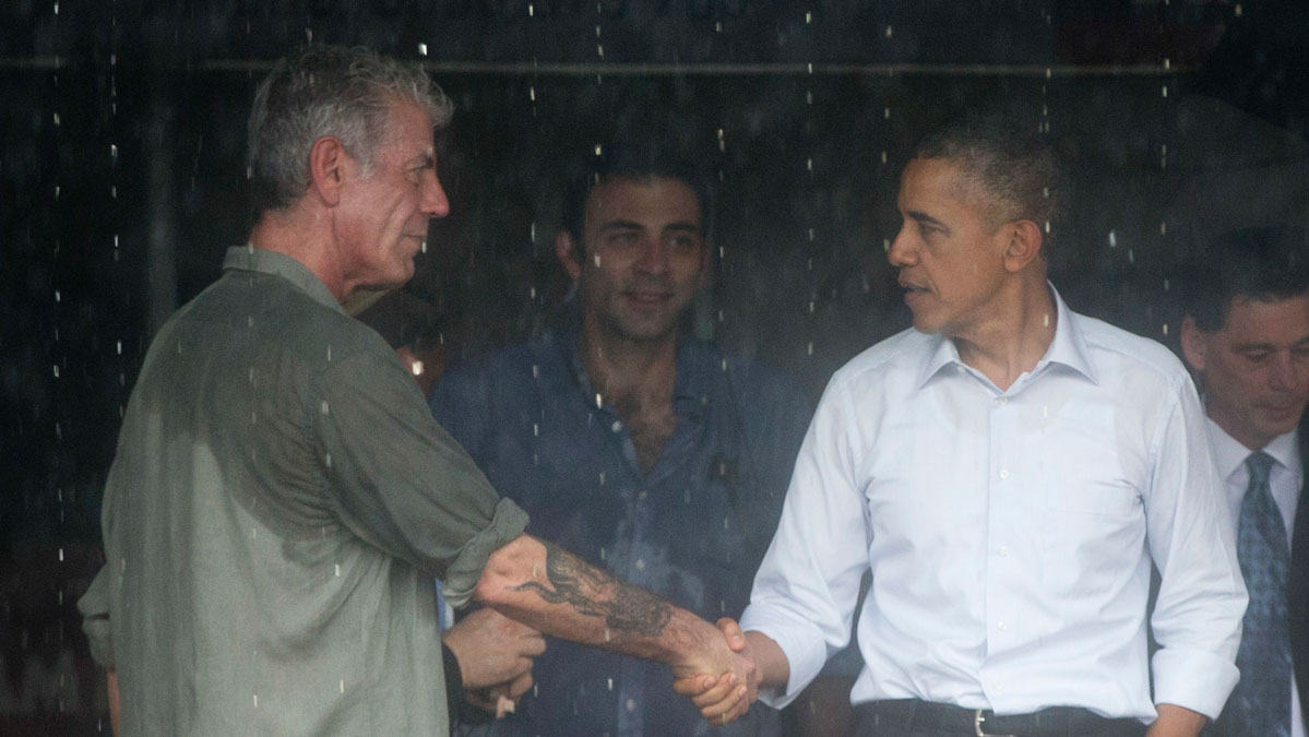 President Barack Obama shakes hands with Anthony Bourdain after visiting with him in a shopping area in Hanoi, Vietnam, Tuesday, May 24, 2016.