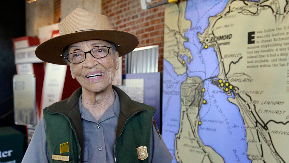 National Park Service Ranger Betty Reid Soskin smiles Tuesday, July 12, 2016, at the Rosie the Riveter World War II Home Front National Historical Park in Richmond, California. The nation's oldest full-time park ranger at 94, Soskin was greeted with cheers and hugs when she returned to work three weeks after an assailant attacked and robbed her in her San Francisco Bay Area home.
