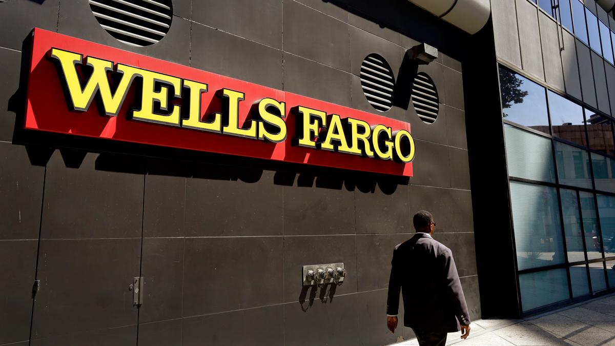 FILE - A Wells Fargo bank office.