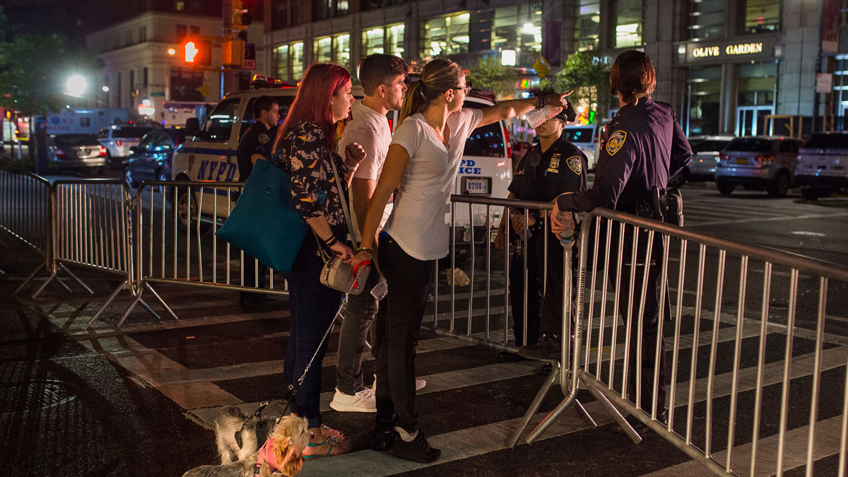 People try to access the area near the scene of an explosion on West 23rd Street and 6th Avenue in Manhattan's Chelsea neighborhood, in New York, early Sunday, Sept. 18, 2016.