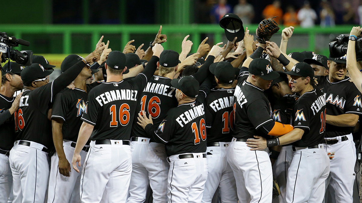Miami Marlins players wearing a jersey in honor of pitcher Jose Fernandez (16) gather around the pitching mound before a baseball game against the New York Mets, Monday, Sept. 26, 2016, in Miami. Fernandez died in a boating accident Sunday.