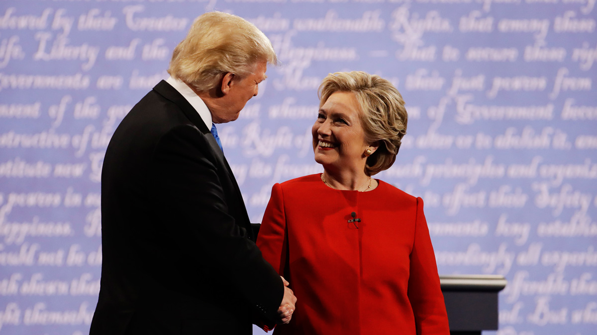 In this file photo, Democratic presidential nominee Hillary Clinton shakes hands with Republican presidential nominee Donald Trump during the presidential debate at Hofstra University in Hempstead, N.Y., Monday, Sept. 26, 2016. A new poll shows that women think less of Trump and better of Clinton following the debate.