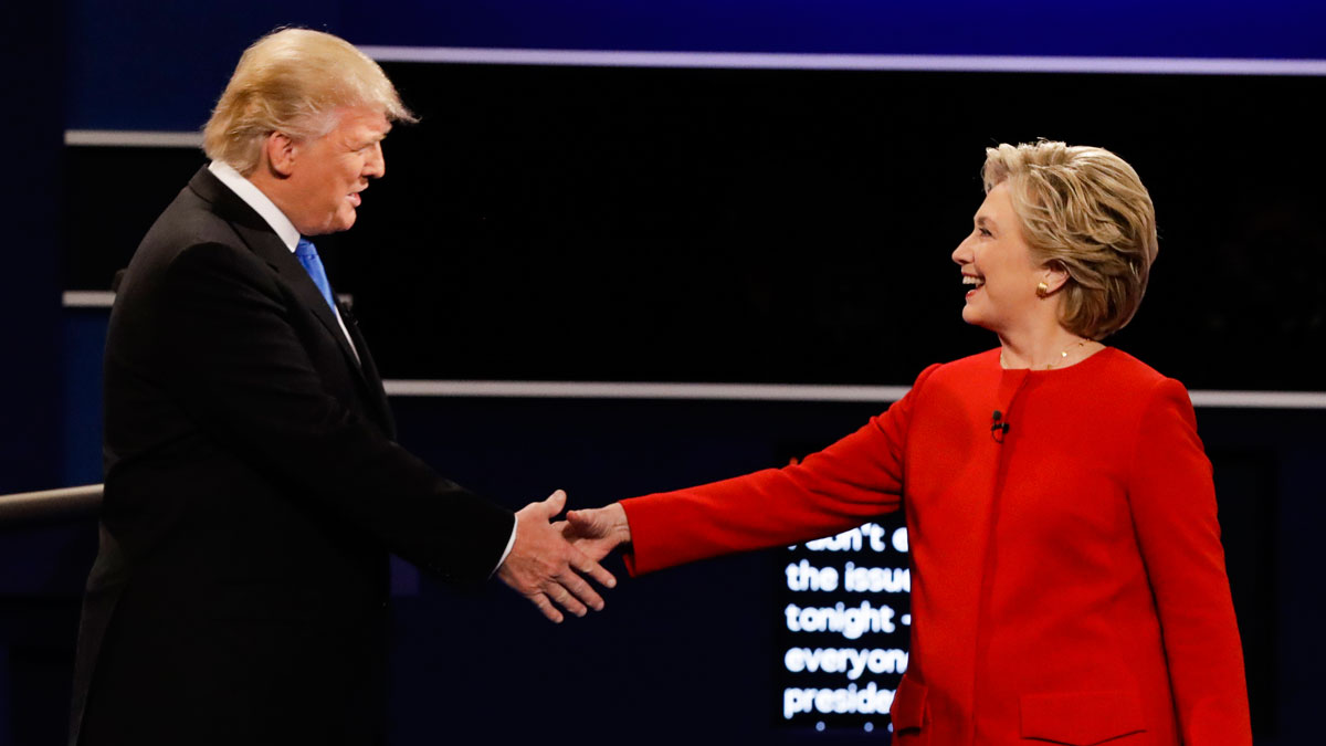 Republican presidential nominee Donald Trump and Democratic presidential nominee Hillary Clinton shake hands during the presidential debate at Hofstra University in Hempstead, N.Y., in this Sept. 26, 2016. A new poll shows Clinton leading Trump nationally.