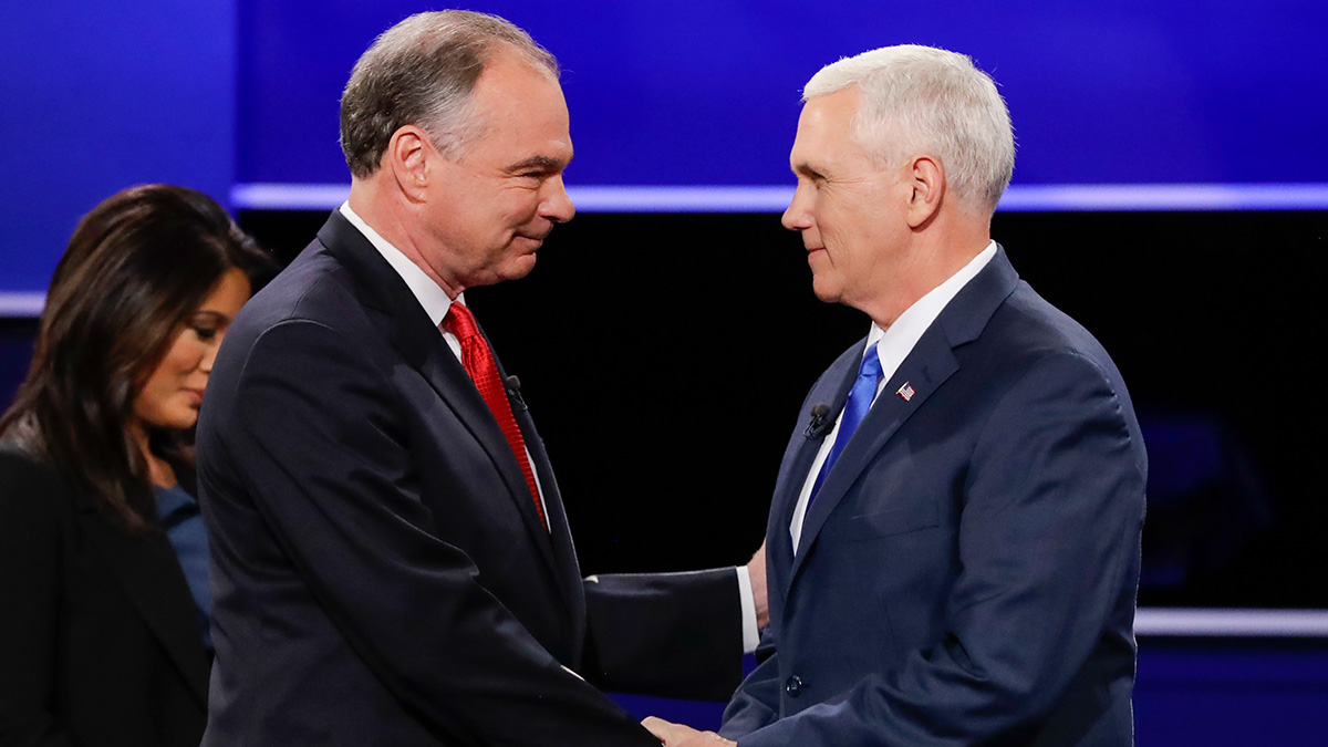 Republican vice-presidential nominee Gov. Mike Pence, right, and Democratic vice-presidential nominee Sen. Tim Kaine shake hands during the vice-presidential debate at Longwood University in Farmville, Va., Tuesday, Oct. 4, 2016.
