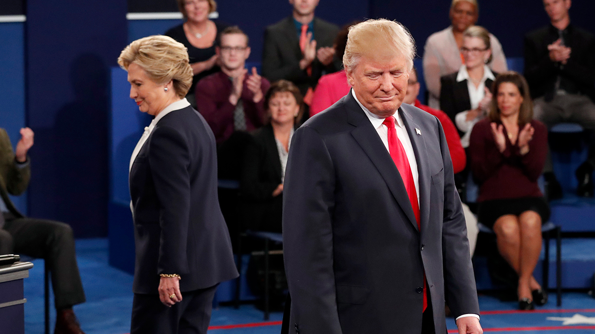 Democratic presidential nominee Hillary Clinton, left, and Republican presidential nominee Donald Trump arrive before the second presidential debate at Washington University in St. Louis, Sunday, Oct. 9, 2016.