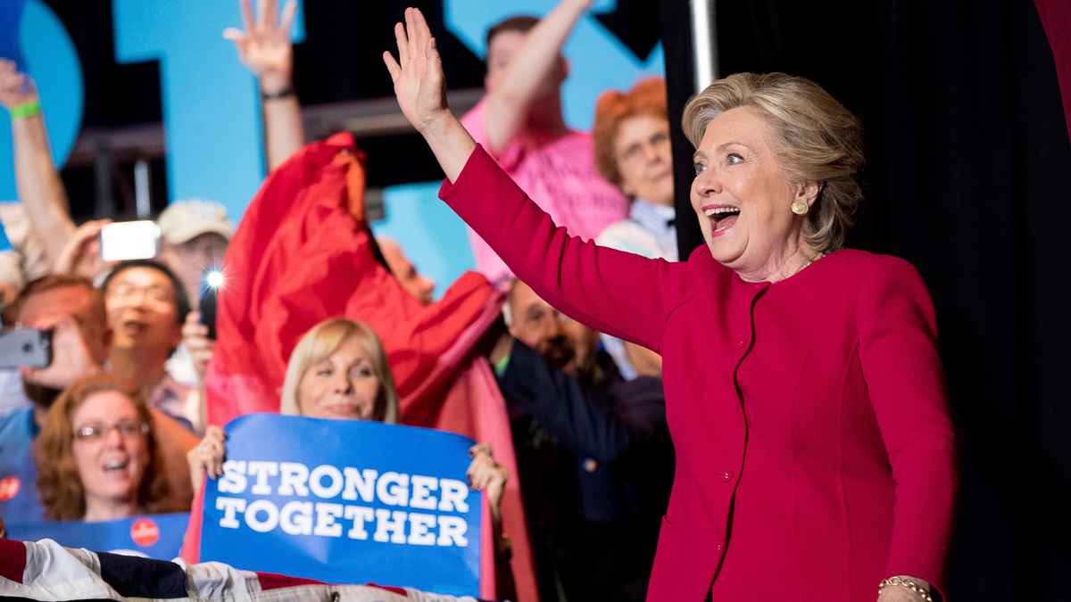 Hillary Clinton waves as she arrives at a rally at Broward College in Coconut Creek, Florida, Oct. 25, 2016.