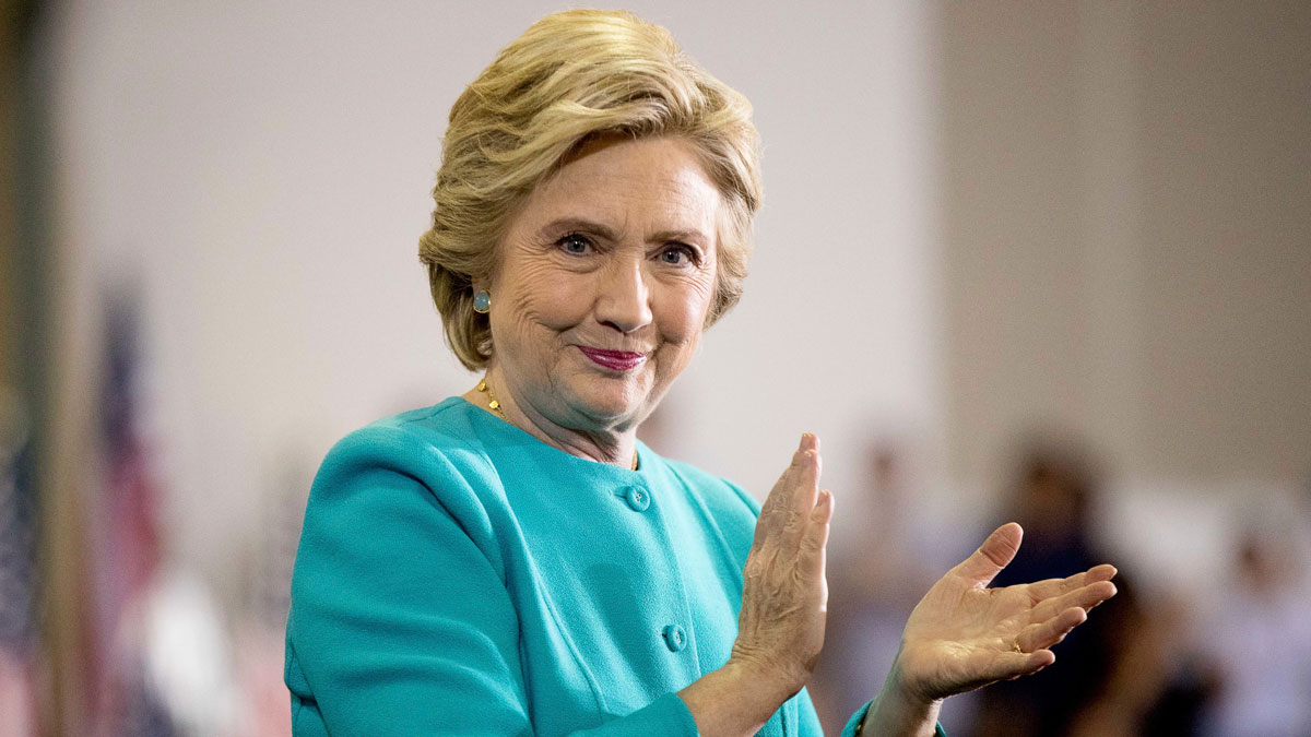 Democratic presidential candidate Hillary Clinton claps as she finishes speaking at a rally at Palm Beach State College in Lake Worth, Fla., Wednesday, Oct. 26, 2016. (AP Photo/Andrew Harnik)