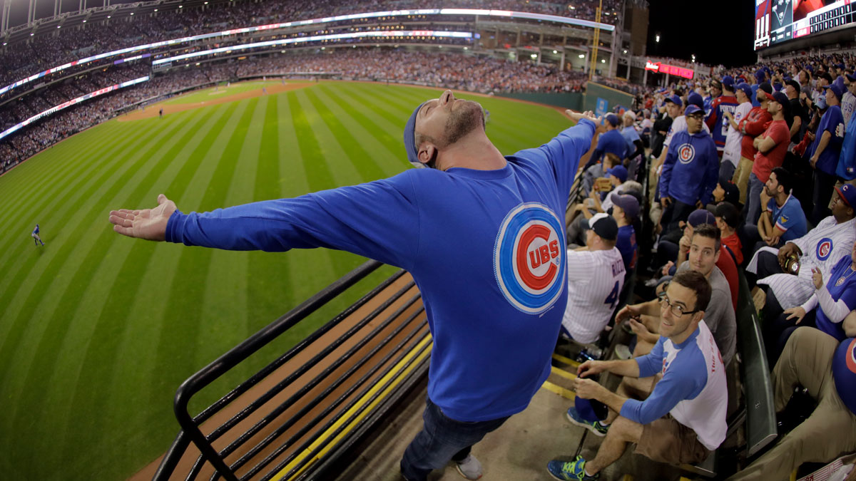 A Chicago Cubs celebrates during the eighth inning of Game 7 of the Major League Baseball World Series against the Cleveland Indians Wednesday, Nov. 2, 2016, in Cleveland.