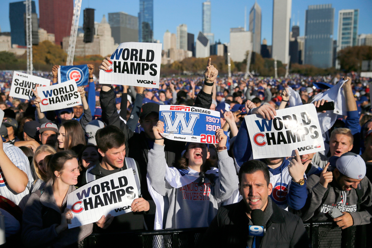 Chicago Cubs fans celebrate before a rally in Grant Park honoring the World Series baseball champions, Nov. 4, 2016, in Chicago.