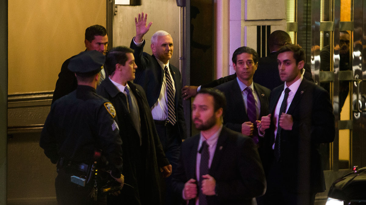 Vice President-elect Mike Pence, top center, leaves the Richard Rodgers Theatre after a performance of