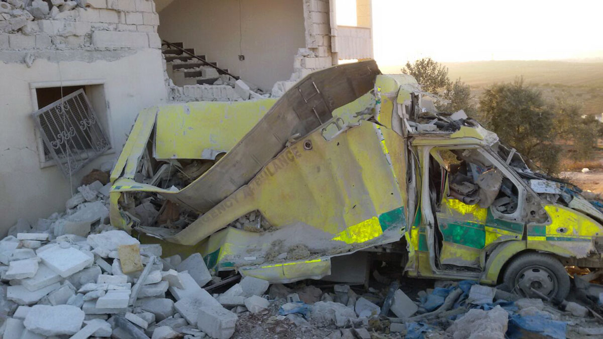 This photo provided by the Shafak Charity Organization, which has been authenticated based on its contents and other AP reporting, shows an ambulance destroyed following four consecutive airstrikes on a medical facility dedicated to women in the northern Idlib province, Syria, Nov. 25, 2016.