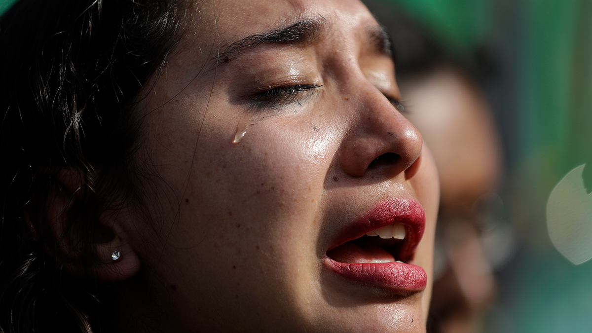 Yoalli Aleida of Mexico City cries during a public tribute where several hundred people gathered to honor late Cuban President Fidel Castro, outside the Cuban Embassy in Mexico City, Sunday, Nov. 27, 2016. Aleida said the death of