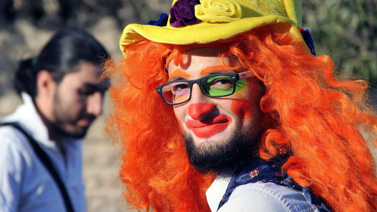 This undated photo courtesy of Ahmad al-Khatib, a media activist in Aleppo, shows Syrian social worker Anas al-Basha, 24, dressed as a clown in Aleppo, Syria.