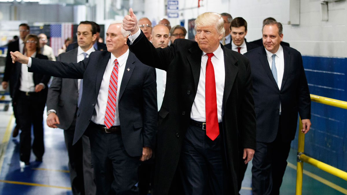 President-elect Donald Trump and Vice President-elect Mike Pence wave as they visit to Carrier factory, Thursday, Dec. 1, 2016, in Indianapolis, Ind.
