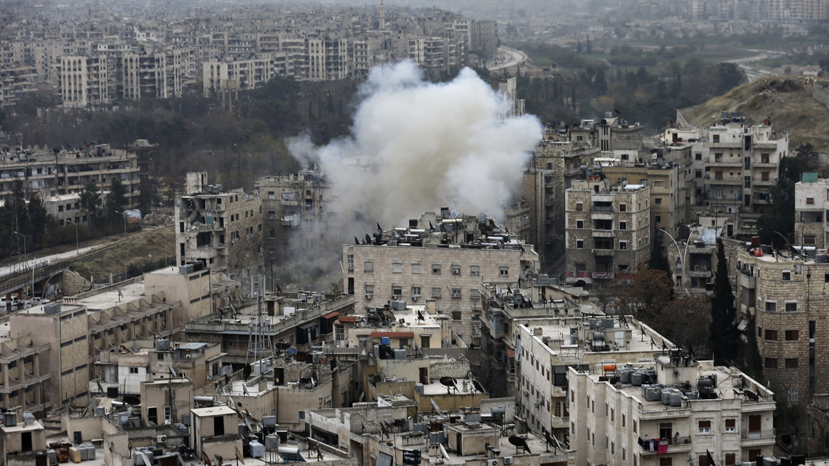 Smoke rises after rebel fighters launch a mortar shell on residential neighborhood in west Aleppo, Syria, Monday, Dec. 5, 2016. (AP Photo/Hassan Ammar)