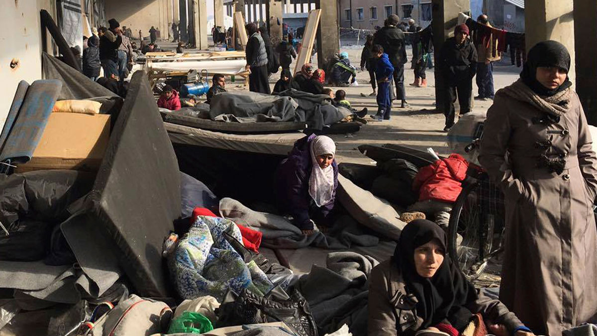 This image released by the International Committee for the Red Cross (ICRC) shows Syrians who were displaced with their families from eastern Aleppo gather at the collective shelter, in the village of Jibreen south of Aleppo, Syria, Monday, Dec. 12, 2016. Syria's military said Monday it has regained control of 98 percent of eastern Aleppo, as government forces close in the last remaining sliver of a rebel enclave packed with fighters as well as tens of thousands of civilians.