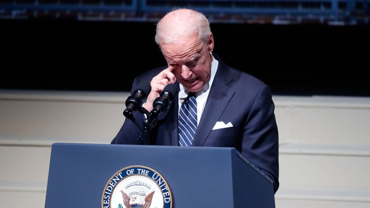 Vice President Joe Biden wipes a tear from his eye as he speaks at the funeral of John Glenn at The Ohio State University, Dec. 17, 2016, in Columbus, Ohio. Glenn, the famed astronaut, died Dec. 8 at age 95.
