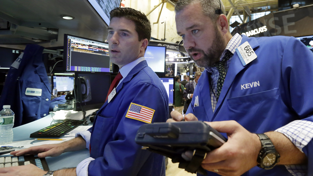 Specialist Thomas McArdle, left, and trader Kevin Lodewick work on the floor of the New York Stock Exchange, Wednesday, Sept. 2, 2015. U.S. and global stock markets were recovering in late morning trading Wednesday after a sharp sell-off a day earlier.