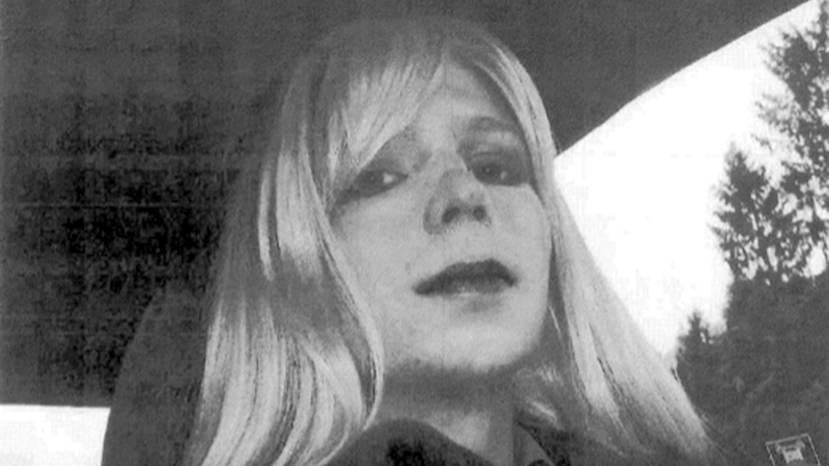 In this undated file photo provided by the U.S. Army, Pfc. Chelsea Manning poses for a photo wearing a wig and lipstick. The former intelligence analyst was convicted of espionage for sending classified documents to the WikiLeaks website.