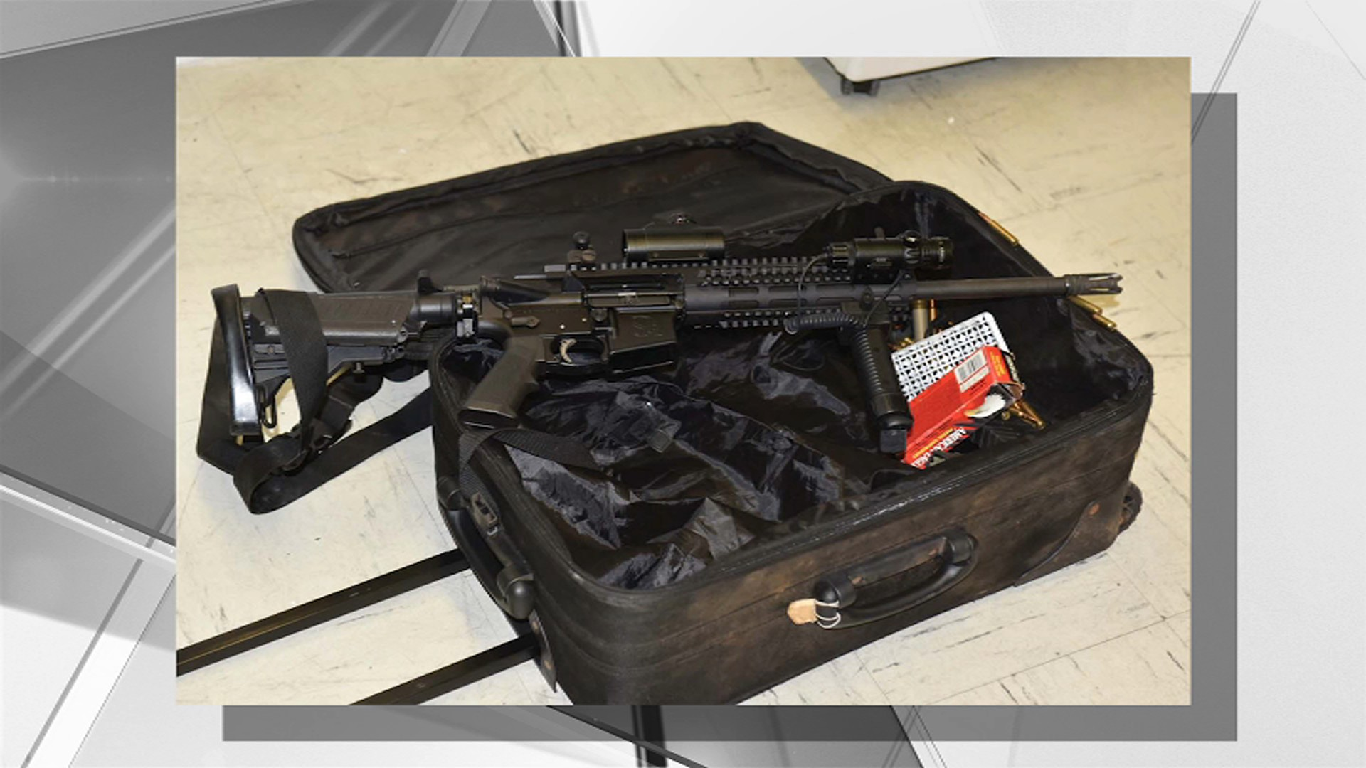 Man Wheels Suitcase With AR-15 Down Street, Throws It at Cop