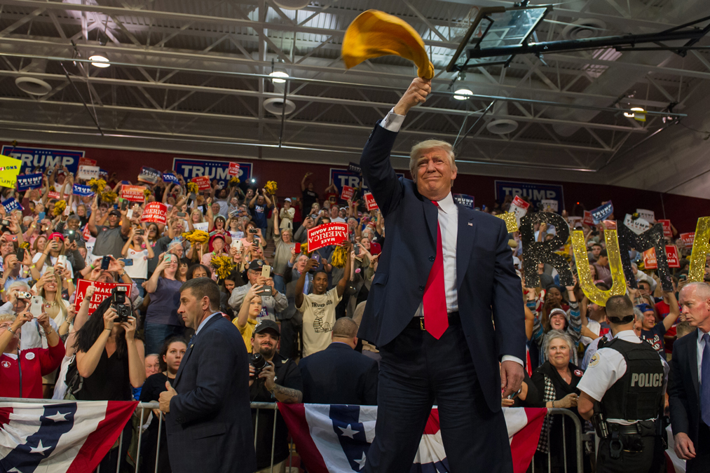ABRIDGE, PA - OCTOBER 10: Republican candidate for  President Donald J Trump waves a Terrible Towel to supporters at a rally at Ambridge Area Senior High School on October 10, 2016 in Ambridge, Pennsylvania. Ambridge, Pennsylvania, named after the American Bridge Company, a steel fabricating plant that employed 60,000 workers is a traditionally Democratic stronghold, but is shifting Republican as a shrinking tax base and lost jobs having devastating economic effects on the former industrial community.  (Photo by Jeff Swensen/Getty Images)