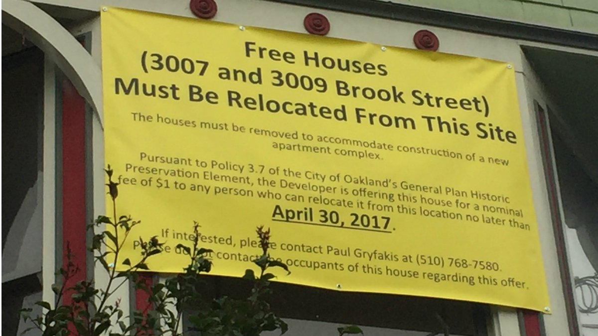two historic oakland houses for sale for only a dollar each to this sign on a victorian house is required by oakland s cultural preservation rules the home is for sale for a dollar but must be moved to make way for an
