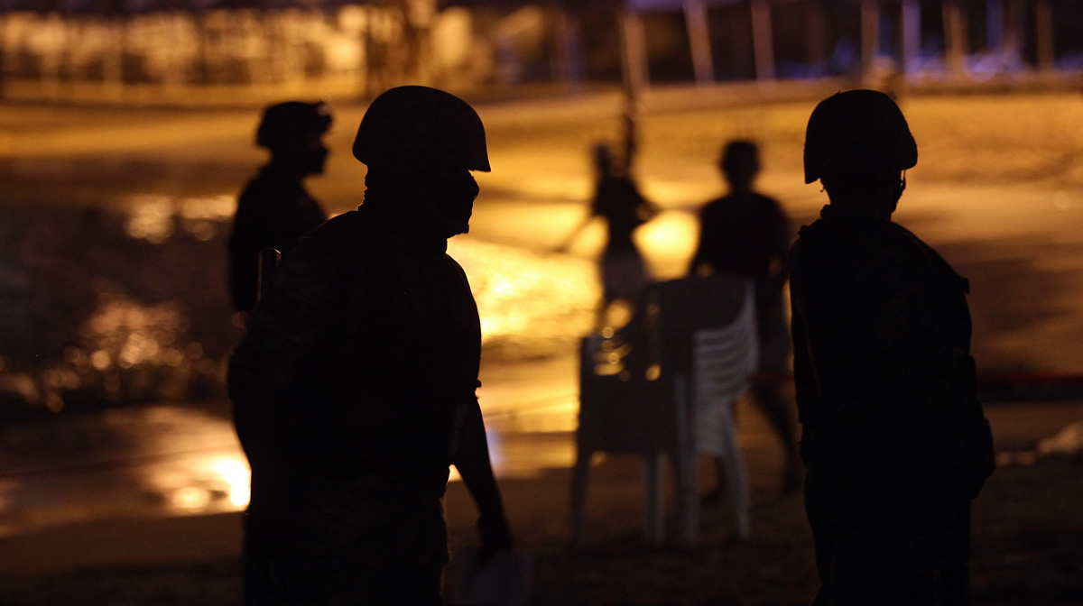 File photo: Mexican soldiers stand guard at the site of a suspected drug-related execution on Acapulco's famous Caleta Beach on March 4, 2012, in Acapulco, Mexico.