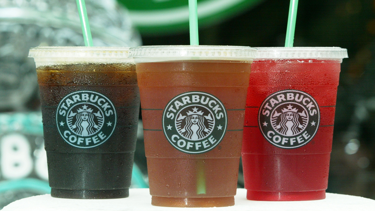 Stock photo -- Starbucks' new iced coffee and tea beverages are displayed during a promotion July 2, 2003 outside a Starbucks coffee shop at Dupont Circle in Washington, DC.